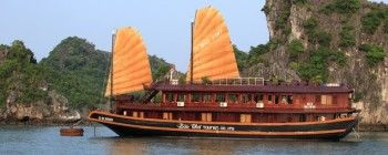 Tourists are enjoying Halong Bay cruise with deluxe Bai Tho Junk - TL104
