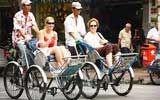 TOURISTS IN Travel by cyclo