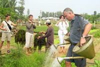 TOURISTS IN Tra Que Vegetable Village by Bicycle Tour