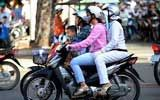 TOURISTS IN Travel by motorbike