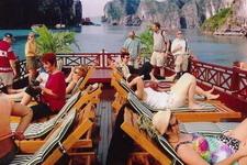 Tourists enjoy sunbathing in Bai Tho Junk