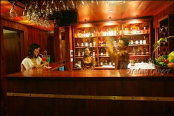 Relax with a cocktail at bar in Halong Ginger Junk, Halong Bay, Vietnam private tours