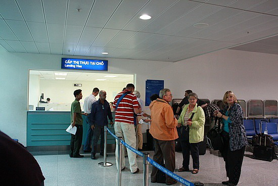 Travelers are getting visa stamped at Tan Son Nhat airport, Ho Chi Minh City, Vietnam